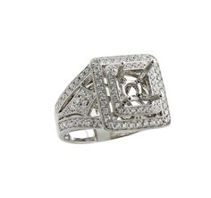This eighteen karat white gold semi mounting engagement ring features 081 carats of diamonds  This ring features a double halo with a split shank  The edges around all of the stones features milgrain which adds extra shine to this impressive mounting