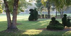 topiary people in park