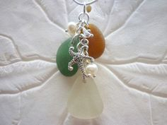 Genuine Sea Glass Necklace Beach Glass Jewelry Seaglass Sterling Pendant  This Beautiful necklace is made from 3 genuine sea glass pieces in deep teal green,light amber and frosty white.  Made entirely of heavy solid sterling silver jump rings. I also included Swarovski crystals and genuine pearls. Pendant also has a highly detailed silver plated pewter Starfish which also has detail to both sides.   Pendant is 2 1/4 inches from the top loop to bottom of glass. These are nice size pieces…