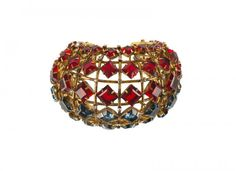 An Iradj Moini goldtone cuff bracelet, set with red and : Lot 1273