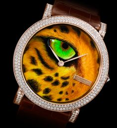 DeLaneau's Tiger's Eye watch has a red gold case set with 184 diamonds and Grand Feu enamel dial.