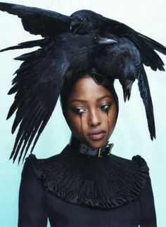 Model: Nyasha Matonhodze  Crow headpiece: Pam Hogg  Dress: Giles Deacon  Stylist: Panos Yiapanis and Katie Grand  Photographer: Mert Alas & Marcus Piggott