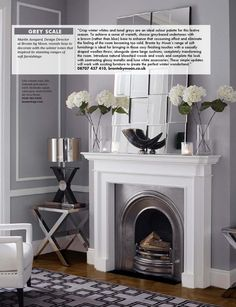 White fireplace with silver insert decorated with complimentary greys and white by Occa Home Fireplace Remodel, Fireplace Mirror, Fireplace Ideas, Beautiful Living Rooms, Modern Luxury, Classic Style, Modern Design, Living Spaces, New Homes