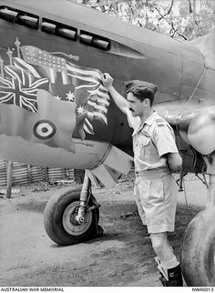 Then Squadron Leader Dick Cresswell, CO of 77SQN, standing beside his P-40 Kittyhawk at Livingstone, NT on 20 January 1943.   The wonderful nose art incorporates the flags/ensigns of the USA, UK, Australia and RAAF. If only the photo was in colour.