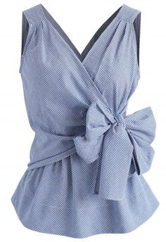 Switch up your professional wear ?and step out in this gingham wrap top. The traditional print gives it a minimalist feel while the self-tie wrap bow keeps it… Blue Gingham Shirts, Bow Shirts, Professional Wear, Wrap Shirt, Unique Fashion, Fashion Design, Trendy Fashion, Blouse Patterns, Mode Style