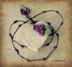 Shabby heart with twisted paper little roses