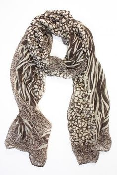 This chic brown animal print scarf is an absolute must-have in every fashionista's wardrobe. Tamsen is lightweight, oversized and versatile for the change in the seasons. Drape it across your shoulders with an LBD, tie it around a gold bikini, or loop it around your neck with a schoolboy blazer. Rihanna is often spotted sporting Tamsen look-a-likes with her favorite denim or leather jackets. Available at sendthetrend.com.