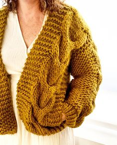 The Cable Bomber by Wool and the Gang is an intermediate level pattern. This kit uses Crazy Sexy Wool and pictured here is the Cable Bomber in Bronzed Olive. This pattern uses techniques such as rib, garter stitch and knitted cables. Shawl Patterns, Sweater Knitting Patterns, Lace Knitting, Knitting Sweaters, Finger Knitting, Patterned Bomber Jacket, Super Chunky Yarn, Fabric Flower Tutorial, Knitted Shawls