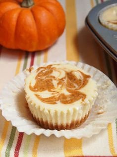 Pumpkin Swirl Cheesecake Cupcakes, I know what I'm making for desert on thanksgiving!