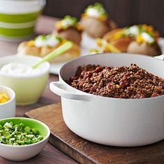 Easy Tailgating Idea: Set out a bunch of toppings and add-ins to great a chili bar for guests to create their own delicious creations.