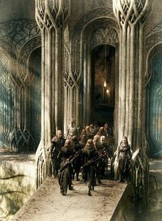 """Across the bridge the e l v e s  thrust their prisoners, but Bilbo hesitated in the rear. He did not at all like the look of the cavern-mouth, and he only made up his mind not to..."