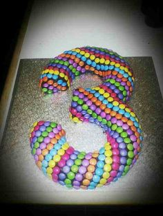 It's simple but very clever and effective. I think it would take a long time to put the smarties on, but worth it.