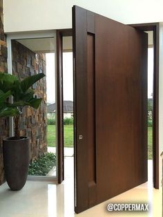 Project developed by architect Lilian Bianccini - Cortén Naturacor® Pivoting Steel Door and Wall Covering: - - Wooden Front Doors, Front Door Entrance, House Entrance, Entrance Doors, Modern Entrance Door, Apartment Entrance, Modern Front Door, Front Entry, Timber Door