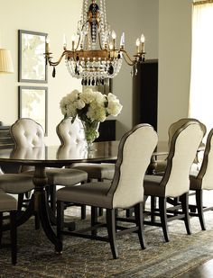 Take A Non Traditional Approach To The Formal Dining Room With Luxurious Tufted Banquette Armand Sutton Oval Table And Beckmore Side