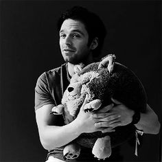 do you see how he's not even squeezing it? He's holding it like if it was an actual living, breathing thing and Oh, my God, he's so darn cute!