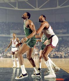 Bill Russell and Wilt Chamberlain  Philadelphia  |  April 5, 1968  |  Photo By Walter Iooss Jr./SI  Two giants of the NBA, Bill Russell of the Boston Celtics boxes out Wilt Chamberlain of the 76ers during a game in Philadelphia.