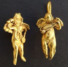 burning passion... Ancient Gold 'EROS' (Goddess of Love) Earrings from Greco-Roman Period... 1-playing a lute, the other holding a disc, in the other hand holding Burning torch, w/chest band diagonally worn, winged backs...