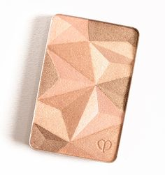 Cle de Peau Sand Beige (13) Luminizing Face Enhancer ($55.00 for 0.35 oz.) is light-medium, gold-shimmered peachy-beige with warm undertones and a luminous finish. Chanel Dentelle Precieuse (LE, $80.00) is very similar, just a bit more beige. Urban Decay Strip Highlighter (P) is warmer. Becca Opal (P, $38.00) is more shimmery, lighter. Dior Transatlantique (LE, …
