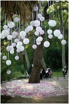 Wedding Decor Idea – Place a marble inside paper lantern or balloon before blowing it up, then, suspend each lantern/balloon with string or ribbon... Love the petals at the bottom of the tree! GREAT IDEA!