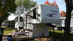 """2010 Used Carriage Cameo 37 RE3 Fifth Wheel in Minnesota MN.Recreational Vehicle, rv, 2010 Carriage Cameo 37 RE3, 2010 Cameo 38 ft. One of the finest build coaches in the industry. 2 Air conditioners, 2 power awnings, 2 full wall slide outs, 1 bedroom slide. table and chairs, ceiling fan, fantastic fan in kitchen, corian counter tops, double fridge and freezer, 32"""" Samsung tv, dvd player, outside shower, big foot auto leveling, frameless windows, tons of storage, heated storage compartments…"""