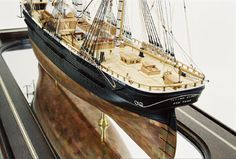 """Extreme California clipper 1851, built by Donald McKay at East Boston. 229' LOA, 40'8"""" beam and 21'6"""" draft and 1,782 tons. Solid hull, planked-over, with copper sheathing. Includes all appropriate deck gear and is authentically rigged, with a slight canting of her yards to a port tack. Scale: 1/8"""" = 1' Size: 39 3/4"""" x 14 1/8 x 27 5/8""""  Class: A"""