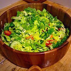 Simple tossed salad romaine lettuce, English cucumbers, cherry tomatoes, shredded zucchini, carrots and Mazetti's simple lemon vinaigrette #dinner #posteorkout #veggieoverload #greens #vitaminfood #delicious #rawvegan #paparoxi