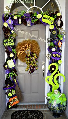 Halloween witch door decor - I like the cauldron on the right