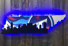 Tennessee Titans with Nashville skyline Tennessee Titans Football, Texans Football, State Of Tennessee, Titan Helmet, Titan Logo, Nashville Skyline, Houston Oilers, Sports Signs, Wall Outlets