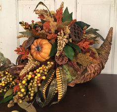 Cornucopia Table Arrangement, Fall Cornucopia, Cornucopia, Cornucopia Arrangement, Fall Cornucopia Arrangement, Fall Table Arrangement. Our beautifully arranged Fall Cornucopia Table Arrangement will enhance your home for the Fall season and the Thanksgiving holiday. Pumpkins, berries, feathers,