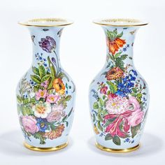 <b>Pair of Paris Porcelain Vases  </b> <br /> 19th Century <br /> Each of baluster form, with cylindrical neck and everted rim, painted with floral bouquets on a powder blue ground. <i>Height 16 inches (40.7 cm).</i> <br />  <br />  <br /> C Property from the Collection of Bennett and Judie Weinstock