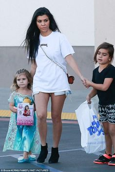 Kourtney Kardashian wearing Saint Laurent Rock Zip Ankle Boot, One Teaspoon Bandits Shorts in Pacifica and Chloe Georgia Convertible Leather Belt Bag