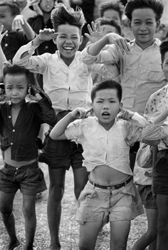 Rene Burri  - South Vietnamese boys watching U.S. Army helicopter take off; Magnum Photos Photographer Portfolio