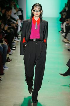 The complete Adam Selman Fall 2018 Ready-to-Wear fashion show now on Vogue Runway.  MENSWEAR - COLOR BLOCK - RHINESTONE TRIM - WIDE LEG PANTS