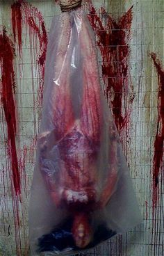 BLOW UP BLOODY BODY BAG Halloween Prop | MonsterMarketplace.com
