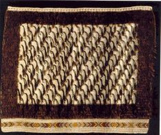 Rangimarie Hetet and Diggeress Te Kanawa. Description:  Korowai made from muka (processed flax fibre). The feathers in the top, right, left and bottom band are weka and pheasant. The body of the cloak is decorated with karure (3 ply thrums) and single weka feathers placed in a diagonal pattern. The bottom is finished with a woven mawhitiwhiti (cross-stitch) pattern interlaced with tanekaha (tan colour) dyed muka followed by a taniko border. Flax Weaving, Flax Fiber, Maori Designs, Maori Art, Easter Island, Weaving Patterns, Kite, Old And New, Animal Print Rug