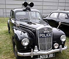 police car - had one of these in 1968 - it cost me £5- with a load of tools in the back and hand-cuff shackles for the back seat :-)