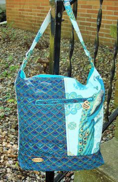 Bonnie-Slouchy Bag,bucket bag, peacock print,handmade purse,shoulder bag,long handle,blue and gold, zipper closure and lined by KarriedAstray on Etsy
