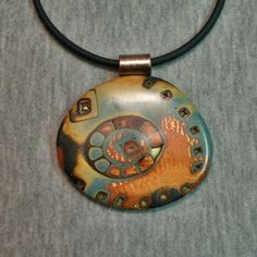 Polymer clay pendant southwest theme