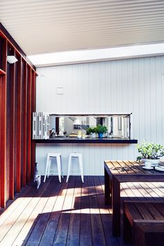 Outdoor entertaining area from affordable new build in Sydney's Northern Beaches by Saturday Studio. Photography: John Paul Urizar | Styling: Louise Bickle | Story: Australian House & Garden