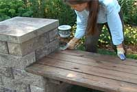 Building a Garden Bench An AB Courtyard bench is a way to add beautiful accents and seating to any landscape. You can build it on an existin... Gazebo With Fire Pit, Fire Pit With Rocks, Backyard Creations, Wall Bench, Patio Bench, Garden Benches, Balcony Garden, Garden Furniture, Garden Fire Pit