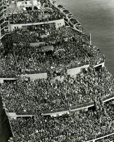 13. Packed like sardines across all decks on the Queen Elizabeth liner, this image from 1945 is of troops being brought home to the New York harbor at the end of World War Two.  Read more at http://all-that-is-interesting.com/history-bizarre-photos/3/#k7Hxfhc9T9Z0PB2