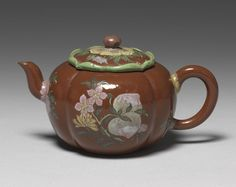 Teapot with symbols of longevity Yixing earthenware, painted enamel Qing dynasty, Kangxi reign, 1662-1722 National Palace Museum
