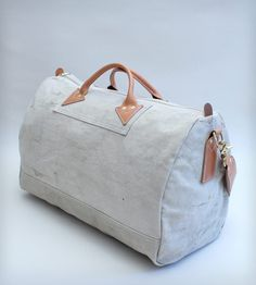 Vintage Fabric Duffle Bag by W Durable Goods on Scoutmob Shoppe. The perfect weekend beach trip bag, made with English bridle leather and vintage fabric.