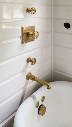 Home Decoration Painting Gorgeous bathroom boasts glossy white shiplap walls lined with an antique gold shower kit and an .Home Decoration Painting Gorgeous bathroom boasts glossy white shiplap walls lined with an antique gold shower kit and an . Shiplap Bathroom, Gold Bathroom, Bathroom Faucets, Modern Bathroom, Bathroom Hardware, Brass Hardware, Brass Bathroom Fixtures, Brass Kitchen Faucet, Bathroom Tray
