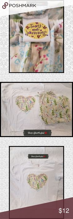 """🆕️Listing 💚Toast & Jammies Pajama Set/Loungewear 🆕️💚 Listing Just added💙💚  Pajama set/lounge wear size Large Good gently used condition Crop Length pants/may be ankle length for under 5'5"""" T shirt-- decorative heart in center and Hilton Head Island written side Purchased set at a resort boutique on Hilton Head Island Very comfy and nice for pjs or just lounging Size large but has drawstring waist pants and adjusts  Likely comfortably fits size 6-12 ladies Good used condition--worn and…"""