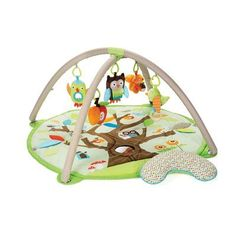 This fun-packed gym offers over 17 developmental activities. Its patterned linen arches have 13 loops to hold one of five hanging toys, while the soft mat features a baby-safe mirror and built-in sounds and textures. Treetop Activity Gym by Skip Hop #IndigoBaby