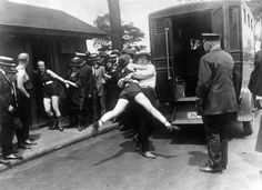Chicago, 1922. Women being arrested for public indecency for wearing one piece bathing suits without the required leggings.