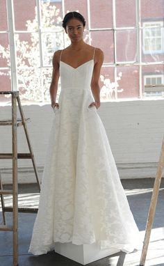 V-neck neckline with spaghetti straps and structured bodice | Lela Rose Spring…