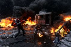 Like a scene from hell, flames engulfed Kiev this week as thousands of masked protesters hurled rocks and Molotov cocktails at heavily armed...