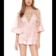 Alice McCall Gypsy Eyes Playsuit The Gypsy Eyes Playsuit features an all over sheer patterned fabric with lovely vine-like pops of 3D floral appliqués. With a super sensual deep V-neckline, keyhole back and matching inner slip. Finished with strong tonal hems on flared sleeves and bottom hem for a perfect kimono-inspired touch! In blush, the sweetest peach-pink that's utterly delectable!      Dry Clean Free People Pants Jumpsuits & Rompers